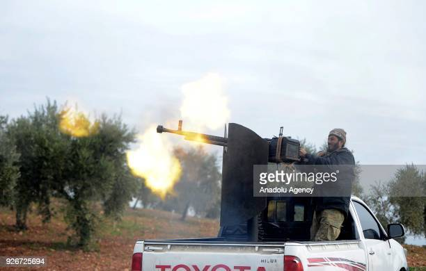 A soldier opens fire with a machine gun loaded on a truck after Free Syrian Army and Turkish Army cleared Ali Bazan Qariqin and Shamanli villages of...