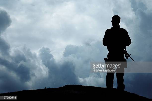 soldier overlooks the horizon - swat stock pictures, royalty-free photos & images