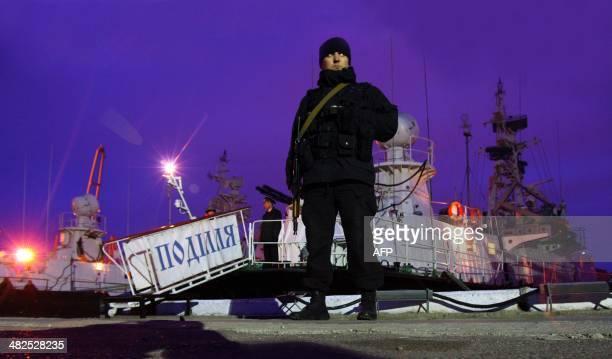 "Soldier patrols alongside Ukrainian border boat ""Podillia"", withdrawn from the Crimean cities of Sevastopol and Yalta to the Black Sea city of Odessa..."