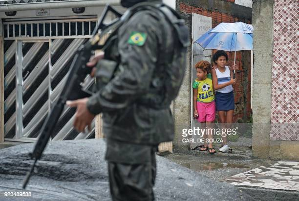 A soldier patrols close to the Vila Kennedy favela in Rio de Janeiro on February 23 2018 More than 3000 soldiers supported Rio de Janeiro police...
