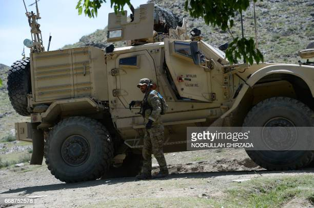 A US soldier patrols near the site of a US bombing during an operation against Islamic State militants in the Achin district of Afghanistan's...