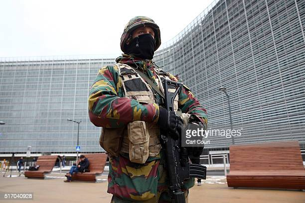 A soldier patrols next to the European Commission headquarters following yesterday's attack on March 23 2016 in Brussels Belgium Belgium is observing...