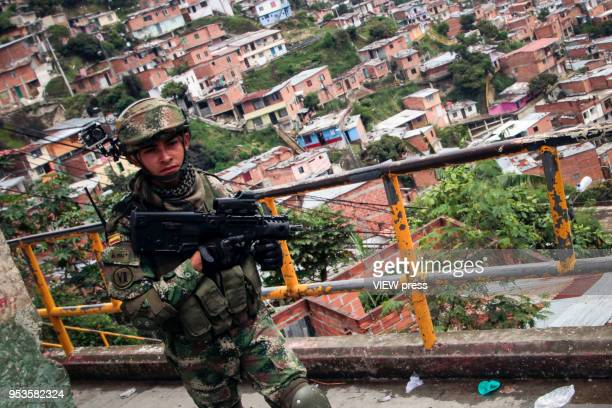 A soldier patrols on foot the alleys of the neighborhood Comuna 13 militarized after the increase in violence between gangs on April 27 2018 in...