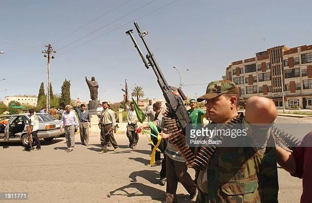 Soldier patrols on the streets April 10, 2003 in Kirkuk, northern Iraq . Kurdish peshmerga guerrillas and U.S. Special operations soldiers took the...