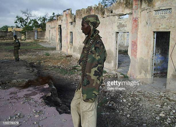 A soldier patrols outside the Gift of Givers makeshift hospital on August 2 2011 in Somalia South African based disaster relief organisation 'Gift of...