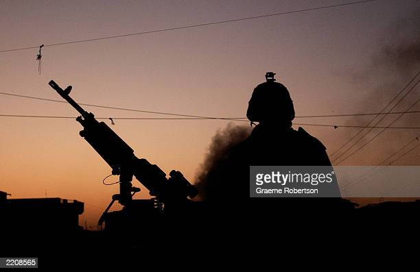 S soldier patrols streets July 26 2003 in Baghdad Iraq US soldiers patrol the outskirts of the city to make sure there is no trouble Three US...
