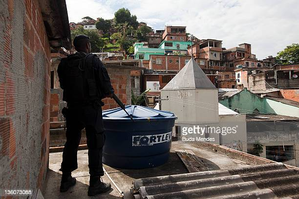 A BOPE soldier patrols the area during the opening of a new Peacemaker Police Unit program at the Morro dos Macacos slum on November 30 2010 in Rio...
