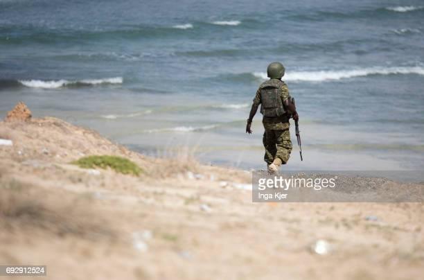 A soldier patrols the coast off Mogadishu on May 01 2017 in Mogadischu Somalia