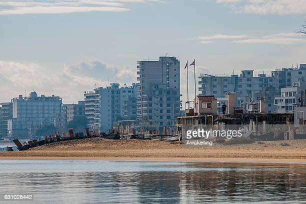 Soldier patrols the wall on the beach that skirts the Varosha quarter on January 5, 2017 in Famagusta, Cyprus. Prior to the Turkish invasion of...