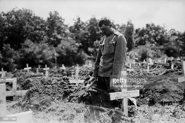 A soldier paying his respects to a fallen comrade in Belgrade