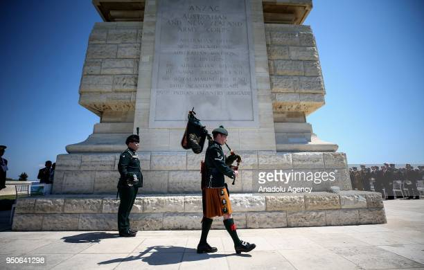 A soldier plays a bagpipe during a ceremony at Helles Memorial in Gallipoli Peninsula within the 103rd anniversary of the Canakkale Land Battles in...