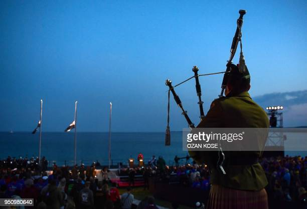 A soldier plays on a bagpipe as people attend a dawn service marking the 103rd anniversary of ANZAC Day in Canakkale Turkey on April 25 2018 The...