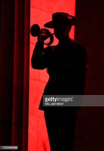 Soldier plays the bugle during an Anzac Day dawn service at the Shrine of Remembrance in Melbourne on April 25, 2021.