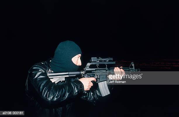 soldier pointing machine gun - machine gun stock pictures, royalty-free photos & images