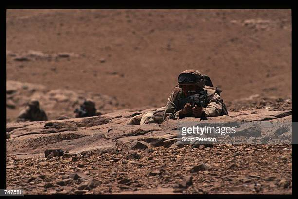 US soldier points a semiautomatic gun as he lays on the ground May 31 1997 in Qatraneh Jordan The forces are taking part in military exercises called...