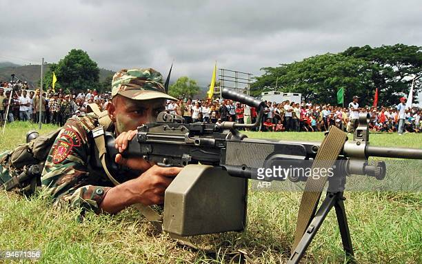 A soldier points his gun as East Timorese soldiers parade during the inauguration of new members of the East Timor Defence Forces in Dili on December...