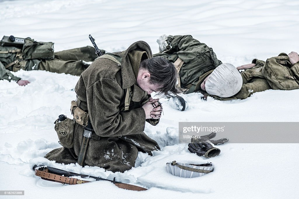 WWII Soldier Praying For Ambushed Comrade War Casualties : Stock Photo