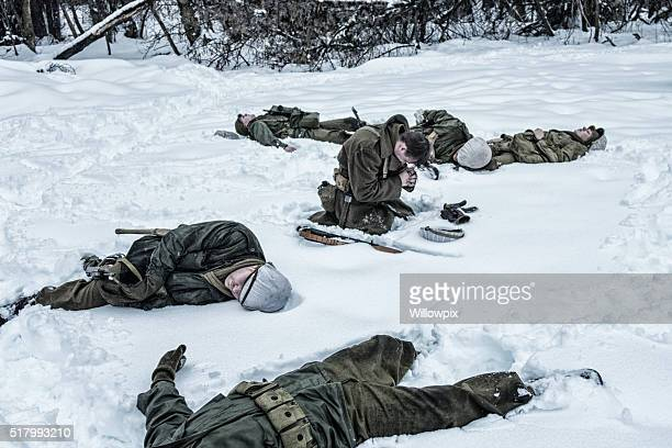 wwii soldier praying for dead ambushed comrade war casualties - soldier praying stock photos and pictures