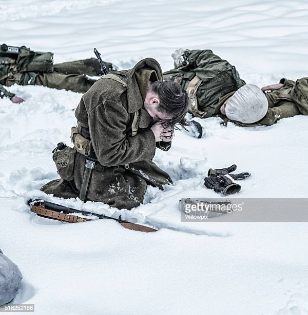 wwii soldier praying for dead ambushed war casualties - soldier praying stock pictures, royalty-free photos & images