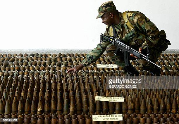 A soldier prepares ammunitions seized to the 47th squad of the Revolutionary Armed Forces of Colombia before being displayed to the press 02 October...