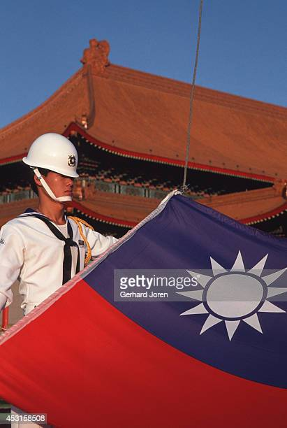 A soldier prepares to raise the Taiwanese flag at Chiang Kai Shek Plaza in Taipei