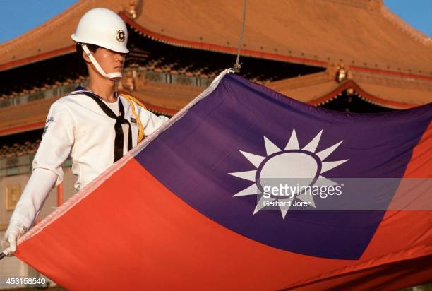 A soldier prepares to raise the Taiwanese flag in Taipei