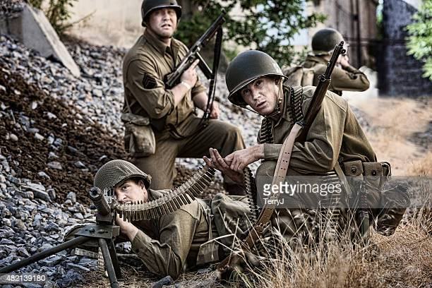 wwii soldier preparing to take out enemy with machine gun - machine gun stock pictures, royalty-free photos & images