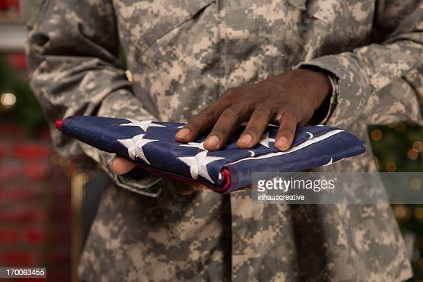 Soldier presenting an American Flag at Christmas