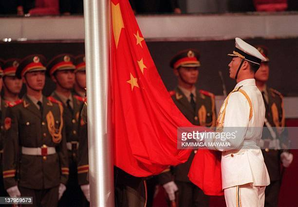 A PLA soldier raises the Chinese flag during the Handover ceremony at the Hong Kong Convention Centre 01 July Hong Kong returned to China after more...