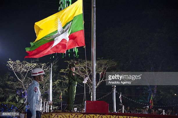 A soldier raises the national flag during a military parade at flaghosting ceremony to mark the countrys 69th Independence Day in Yangon Myanmar on...