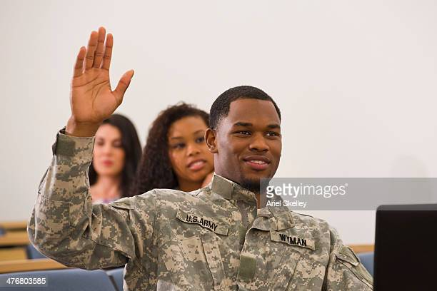 soldier raising hand in classroom - military training stock pictures, royalty-free photos & images