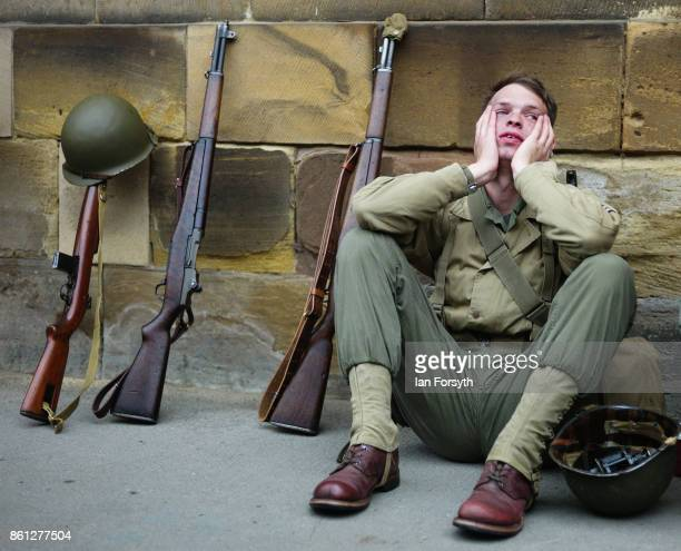 US soldier reenactor rests outside the railway station during the North Yorkshire Moors Railway 1940's Wartime Weekend event on October 14 2017 in...