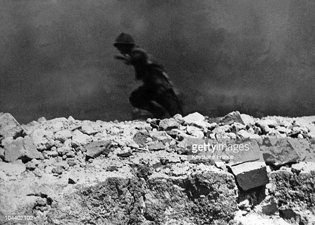 Soldier running from one trench to another during the Battle of DIEN BIEN PHU.