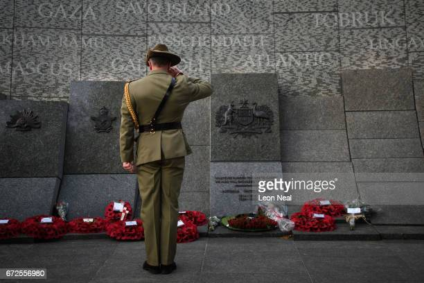 Soldier salutes after laying a wreath on the Australian War Memorial at Hyde Park Corner, following the ANZAC Day dawn service on April 25, 2017 in...