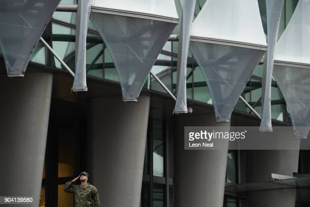 A soldier salutes as the American flag is raised at the new US embassy for the first time on January 12 2018 in London England President Trump has...