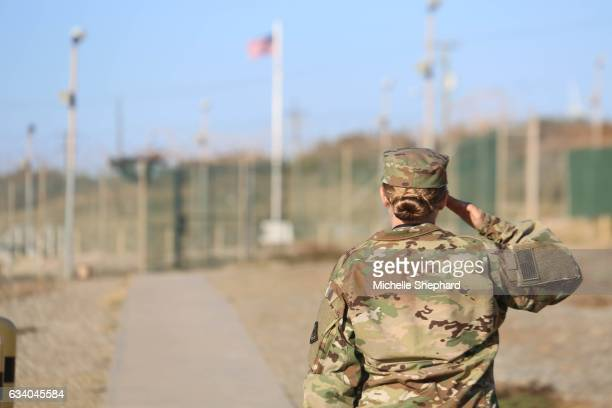 BAY CUBA A soldier salutes during the morning playing of the Star Spangled Banner inside Camp Delta on Jan 28 2017