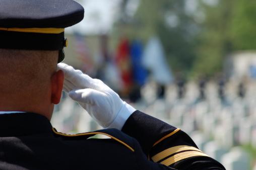 Soldier salutes fallen comrades 104206024