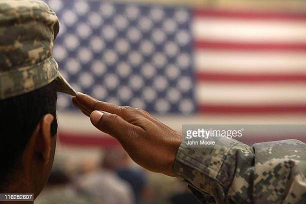 Soldier salutes the flag during a welcome home ceremony for troops arriving from Afghanistan on June 15, 2011 to Fort Carson, Colorado. More than 500...