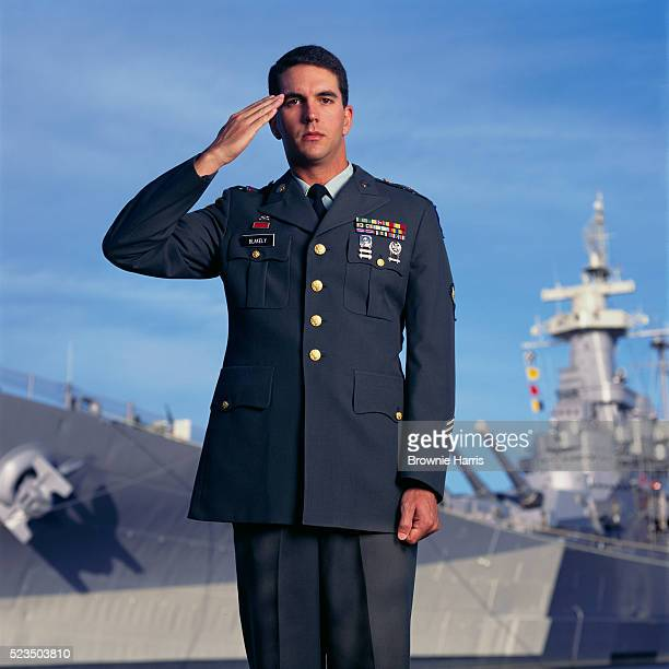 soldier saluting at the uss north carolina battleship - saluting stock pictures, royalty-free photos & images