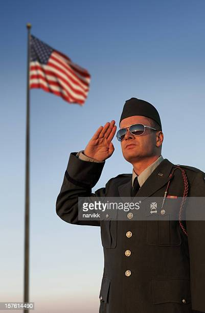 US Soldier Saluting in Front of American Flag