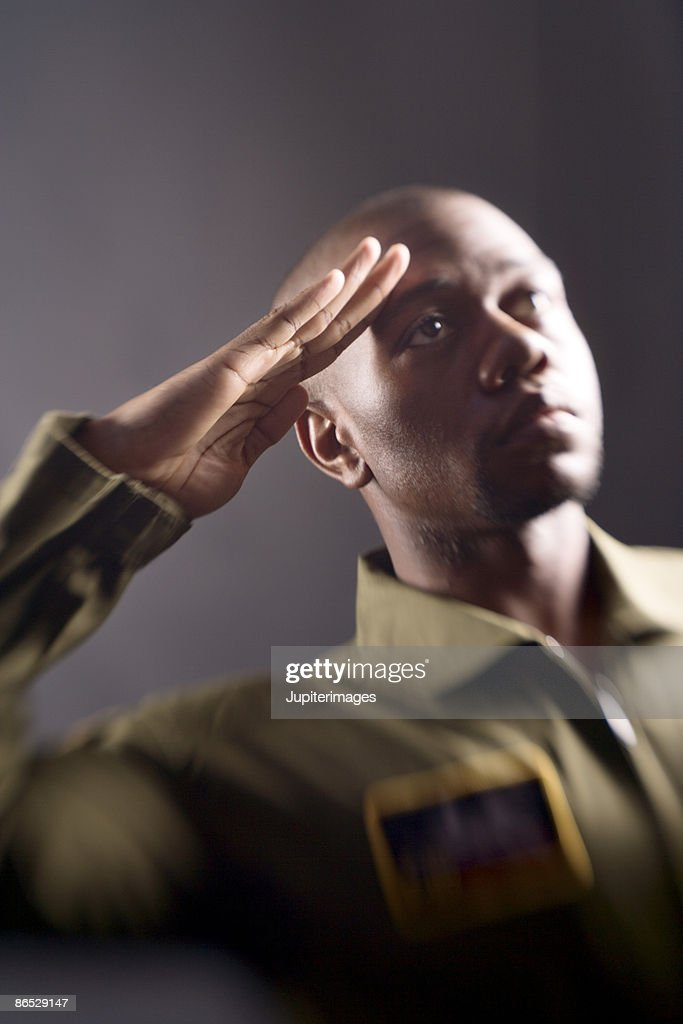 Soldier saluting : Stock Photo