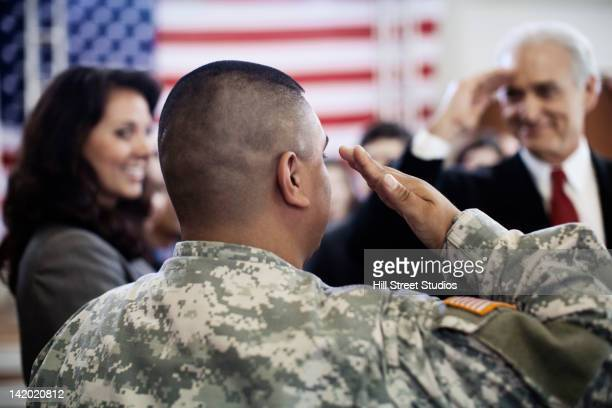 soldier saluting politician at political gathering - marine corps flag stock pictures, royalty-free photos & images