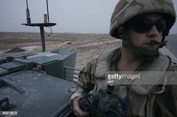 A soldier scans the horizon during a mounted patrol in the air station on 29 April 2008 Fierce clashes between Shiite militiamen and US and Iraqi...