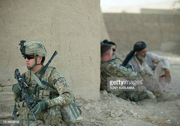 A US soldier secures a position as Lieutenant Jameson Bligh of 1st Platoon Delta Coy 164 AR of the US army operating under NATO sponsored...