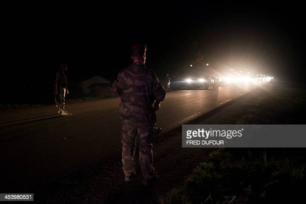 A soldier signals the parking area as French troops taking part in operation Sangaris arrive at a base camp on December 6 2013 in Cameroon on the...