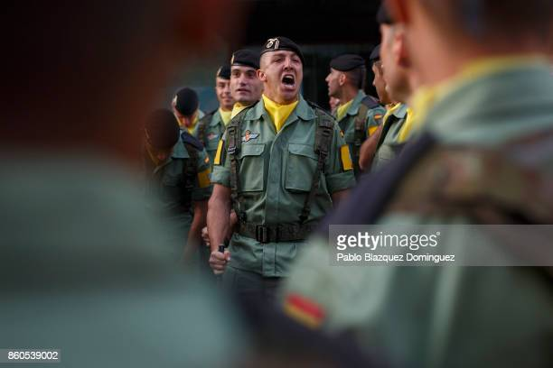 A soldier sings before the start of Spain's National Day military parade at Castellana Street on October 12 2017 in Madrid Spain Every October 12...