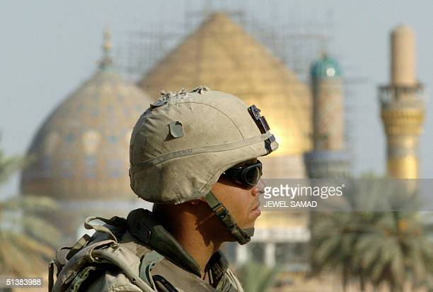 US soldier sits atop of a humvee manning his gun as he patrols past the golden mosque of Imam Hassan alAskari in Samarra 02 October 2004 The...