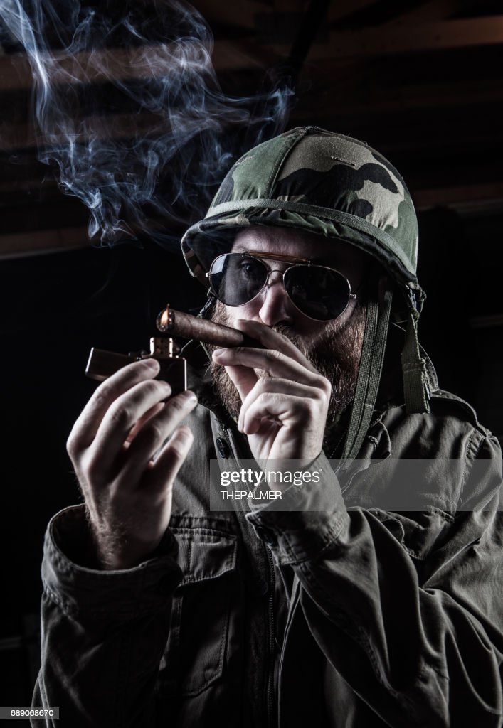 Soldier smoking : Stock Photo