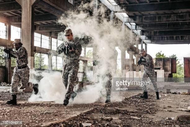 soldier squad team  running at battlefield - military attack stock pictures, royalty-free photos & images