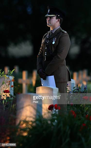 A soldier stands amongst the war graves during a militaryled vigil to commemorate the 100th anniversary of the beginning of the Battle of the Somme...
